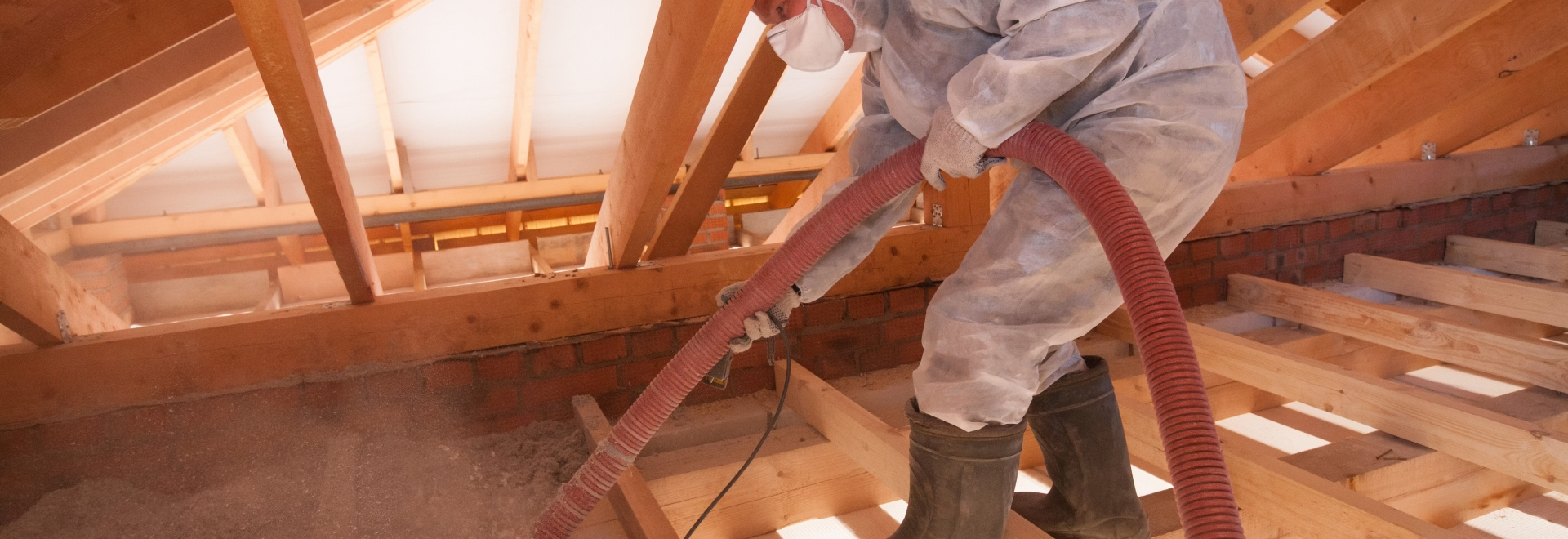 Technician Applying Blown-In Cellulose Insulation